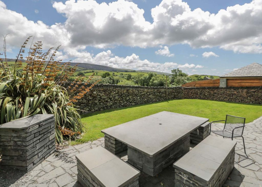 Secure pet friendly garden with lawn and patio