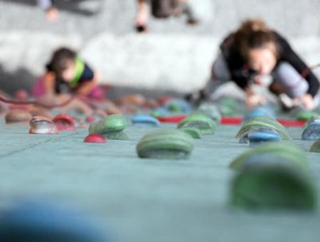 People rock climbing on indoor wall