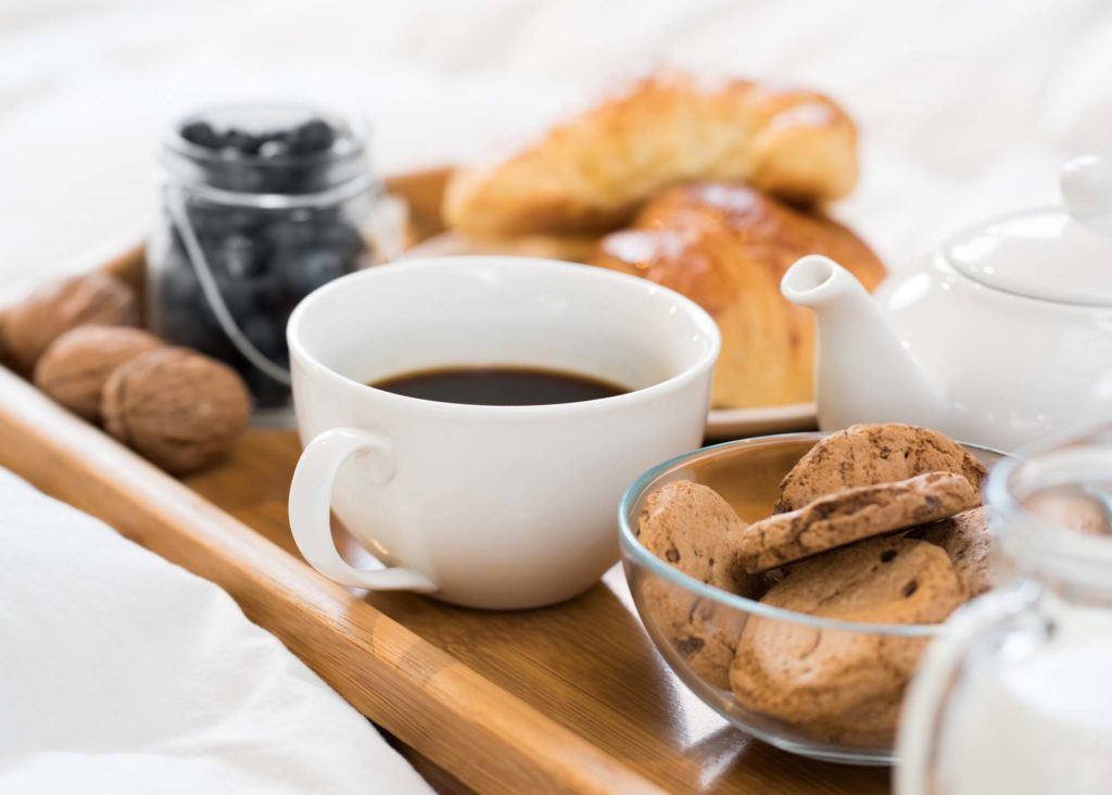 Cup of tea and biscuits in bed