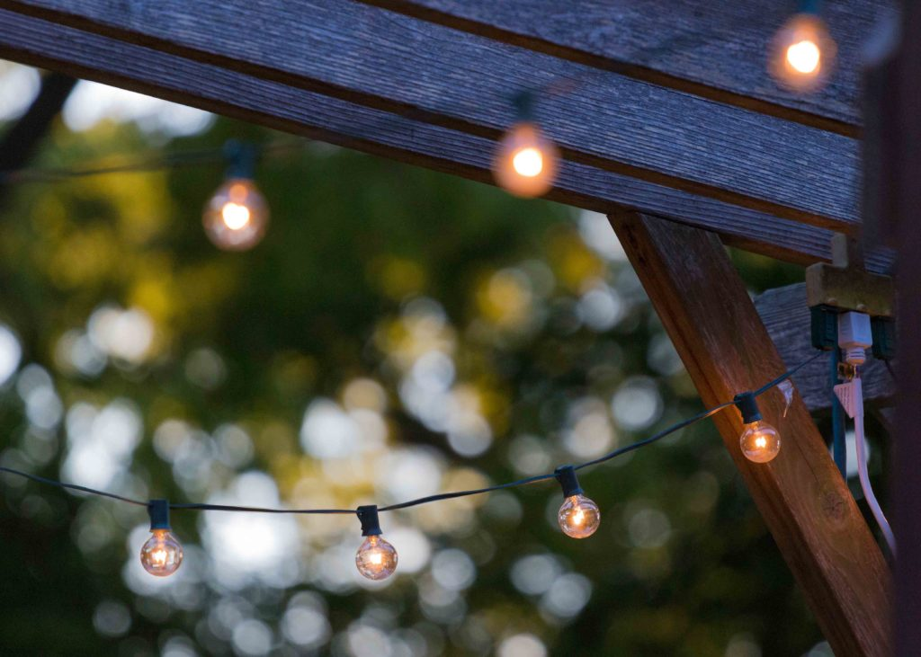 Fairy lights hanging up in a garden