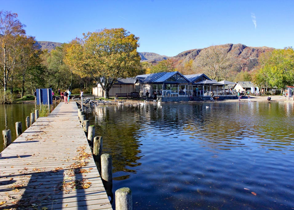 Bluebird Cafe in Coniston with the lake and jetty under blue skies