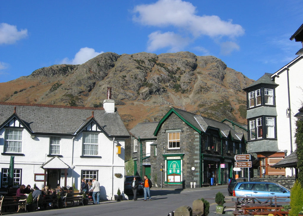 Village of Coniston with buildings and mountains behind