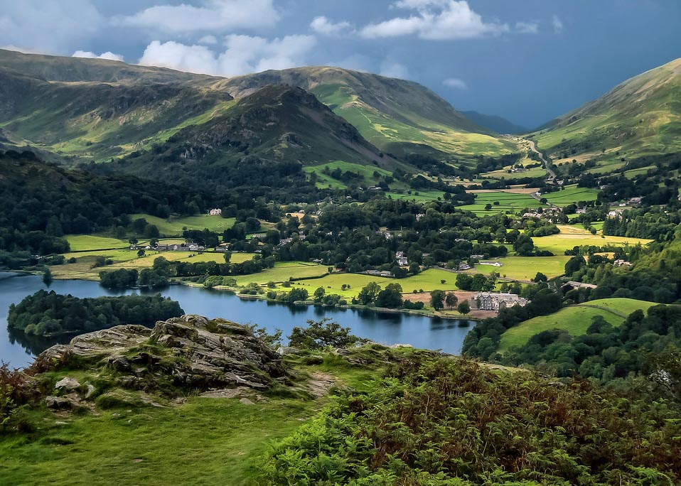 Lakeland village of Grasmere in the valley between green mountains