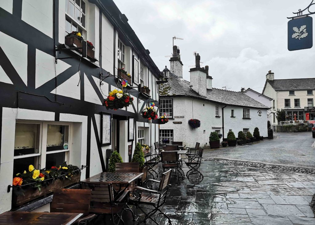 Lake District traditional village with flowers and cobbled streets
