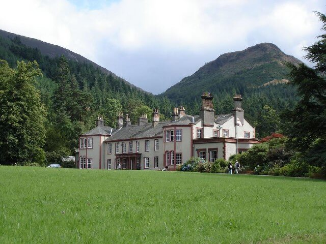 An exterior photograph of Mirehouse and its surrounding gardens