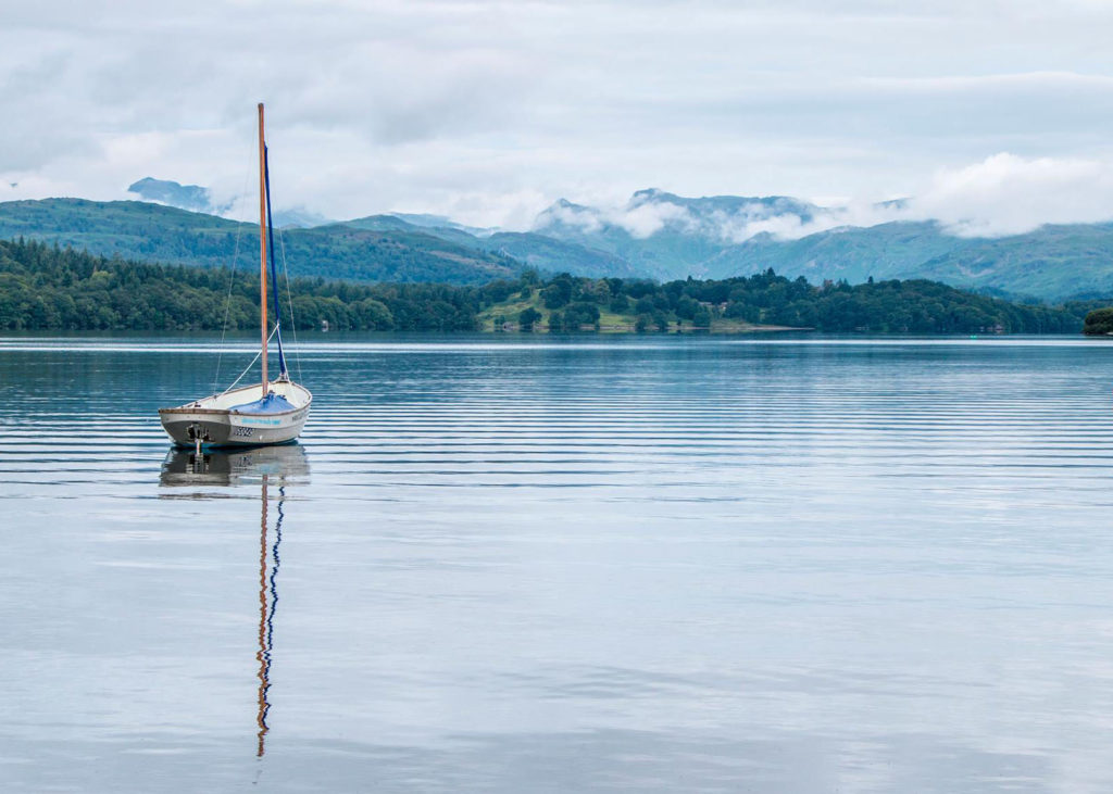 Boat on Lake Windermere with mountains in the background