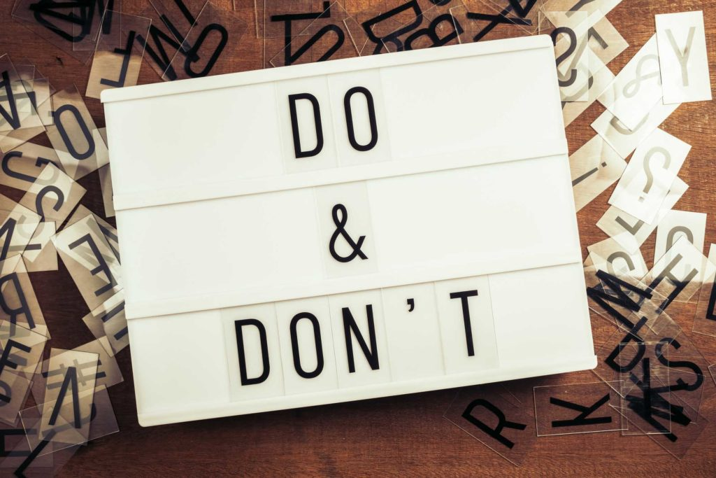 Do and Don't on the lightbox with plastic alphabets scattered on wood background