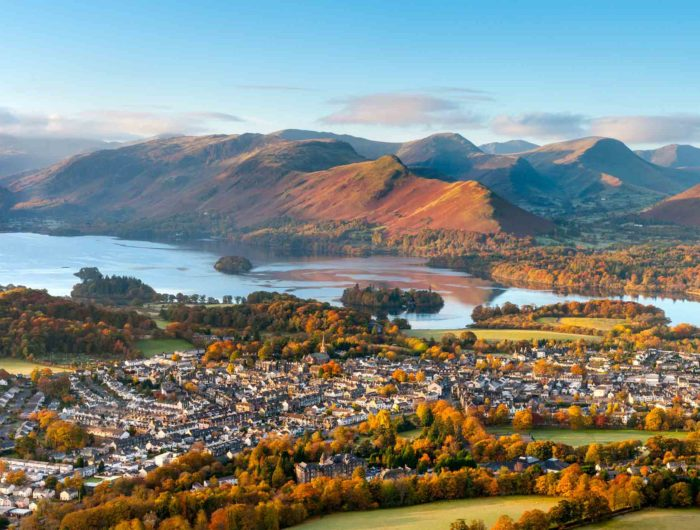 Houses in the town of Keswick with Derwentwater and Catbells mountain in the distance