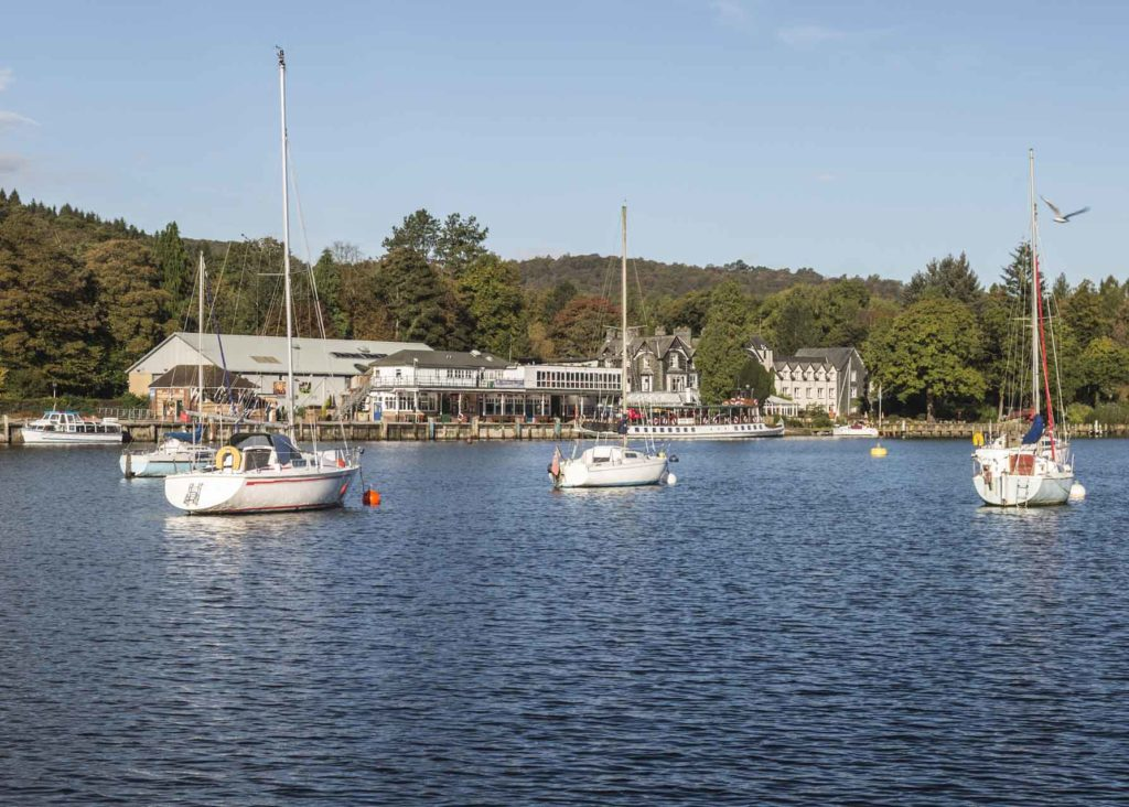 Boats on Lake Windermere with blue sky