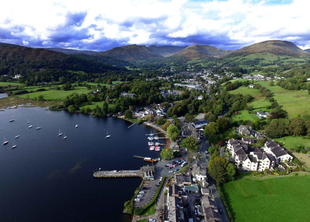 Lake Windermere with boats and houses along the shore