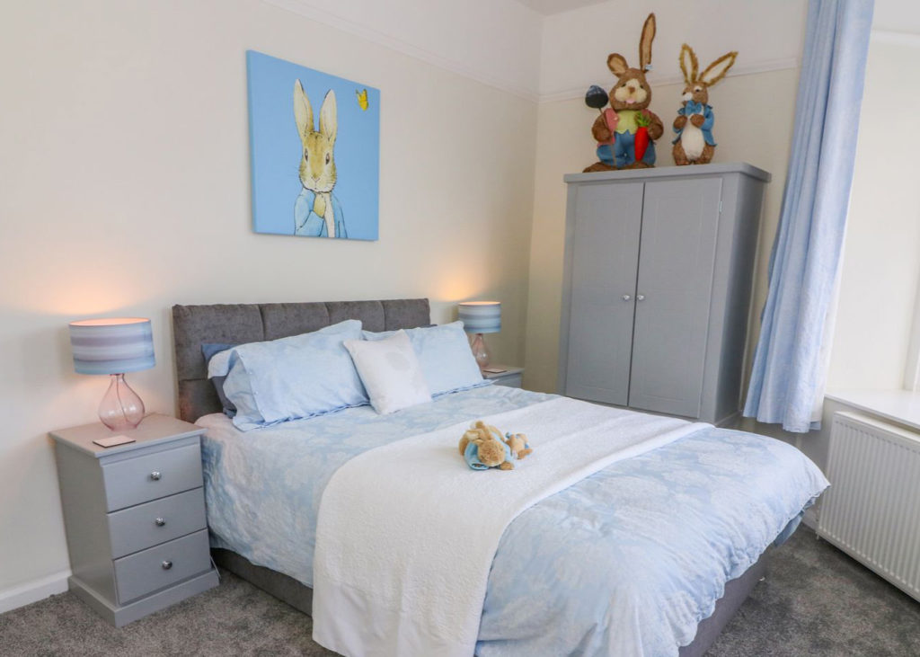 Peter Rabbit themed bedroom with modern furnishings and blue colour scheme