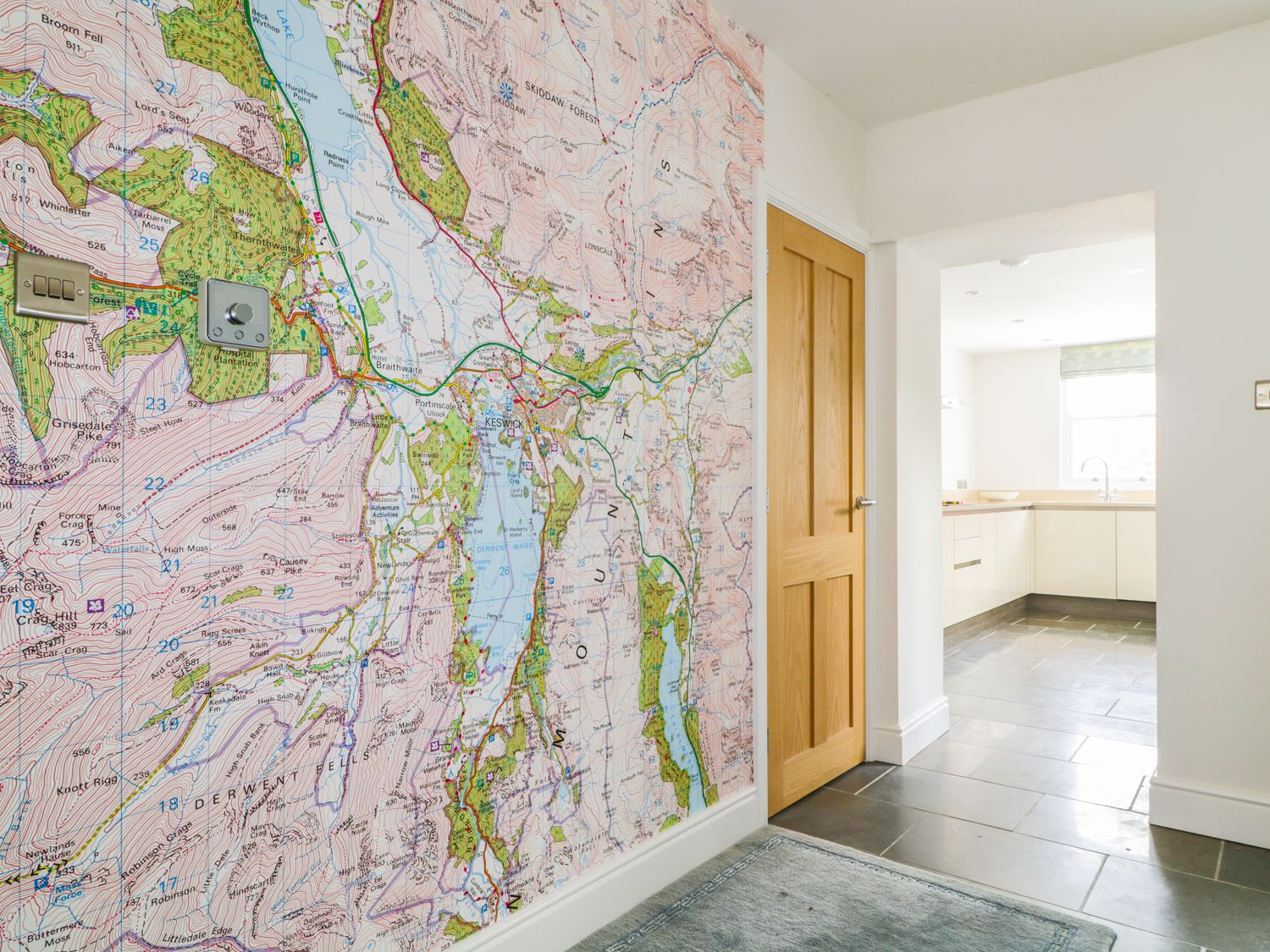 OS maps wallpaper inside a holiday cottage