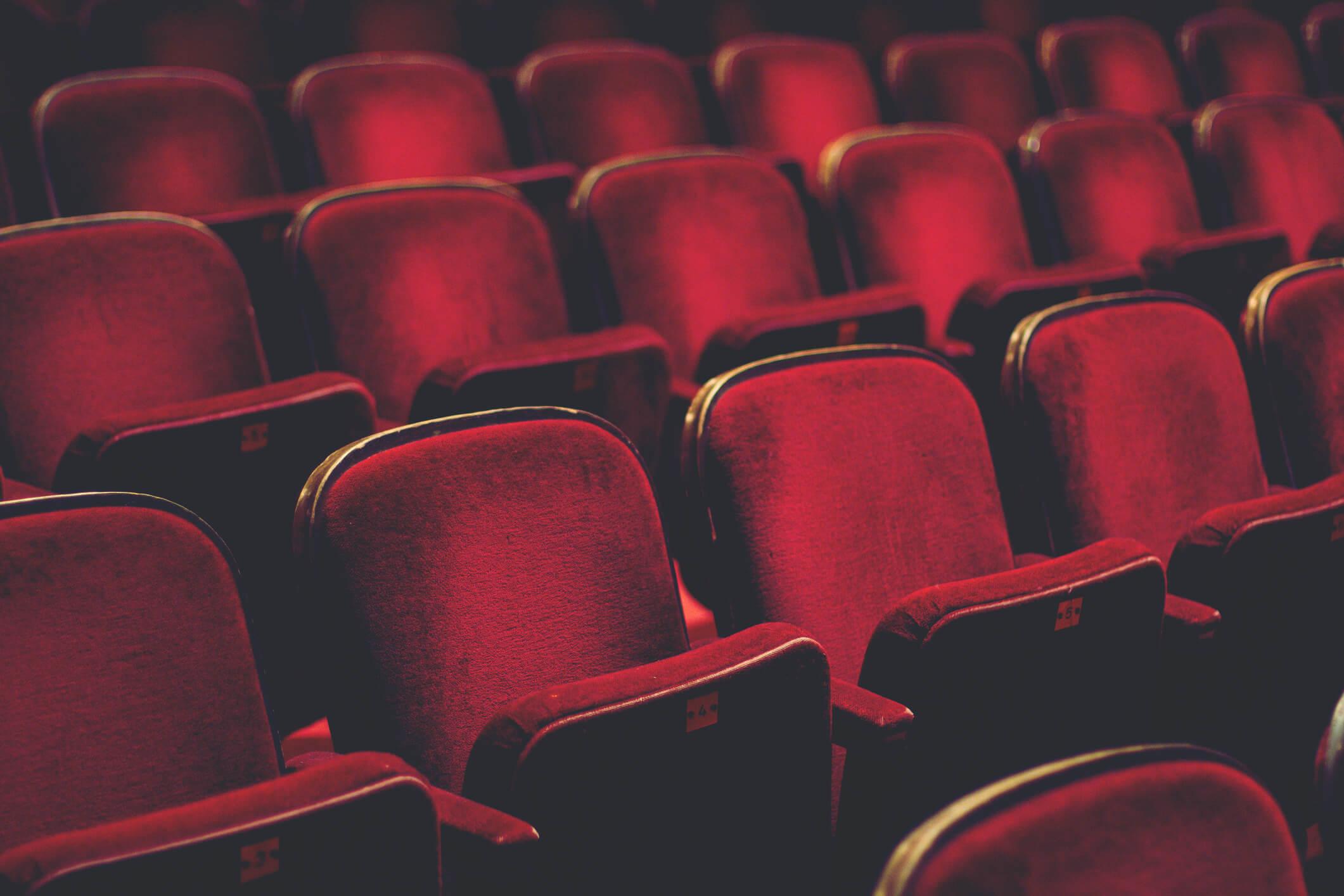 Empty red theatre seats