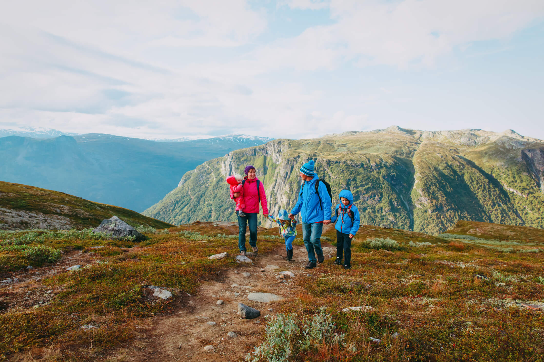 happy family with kids hiking in mountains, travel concept